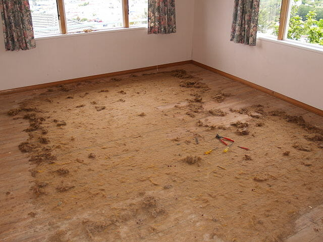 a wooden floor covered in sawdust