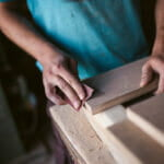 how to sand wood by hand