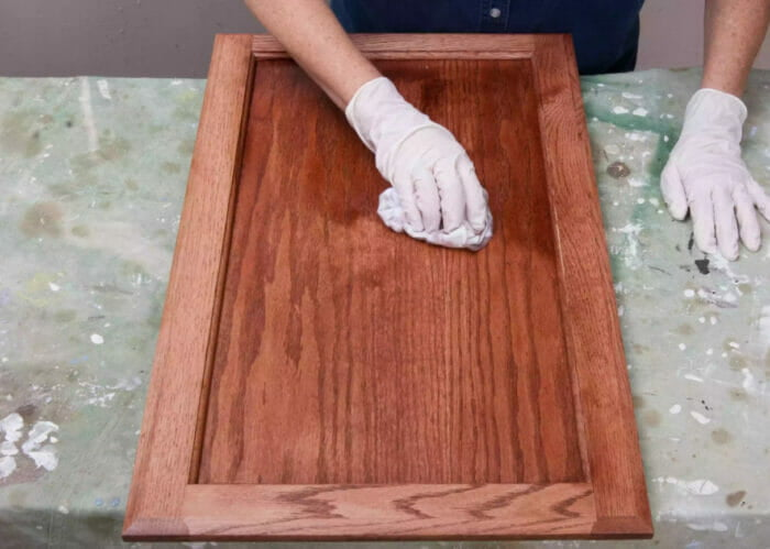 staining the door of a wooden cabinet