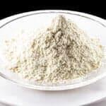 Pile of trisodium chloride phosphate on white background