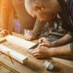a man building his own DIY desk