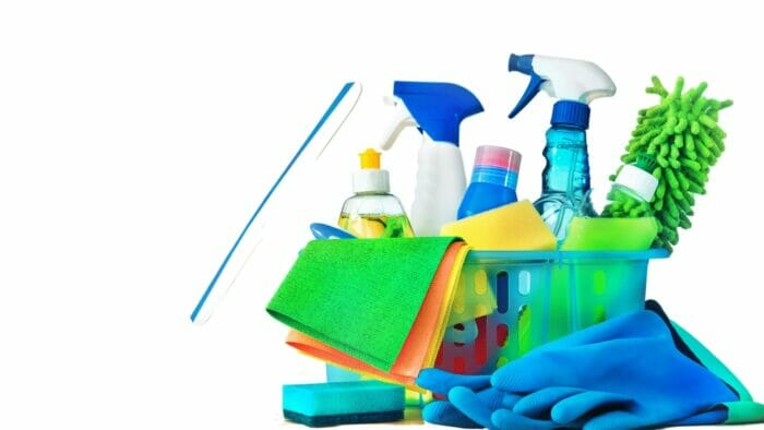 various cleaning products in a plastic basket