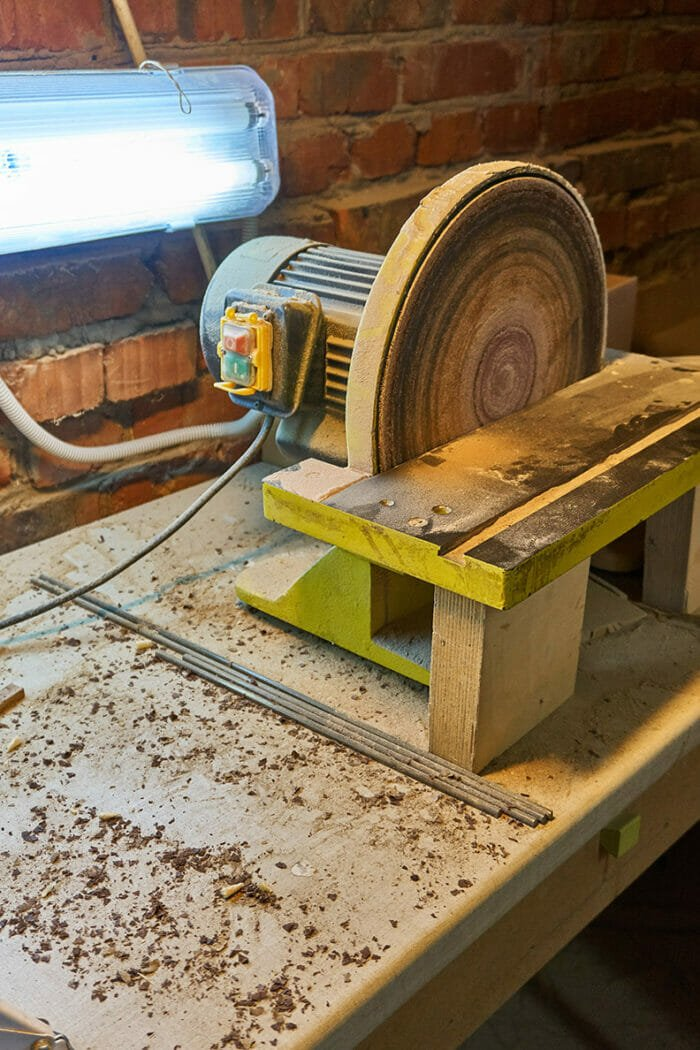 closeup of a mounted disk sander