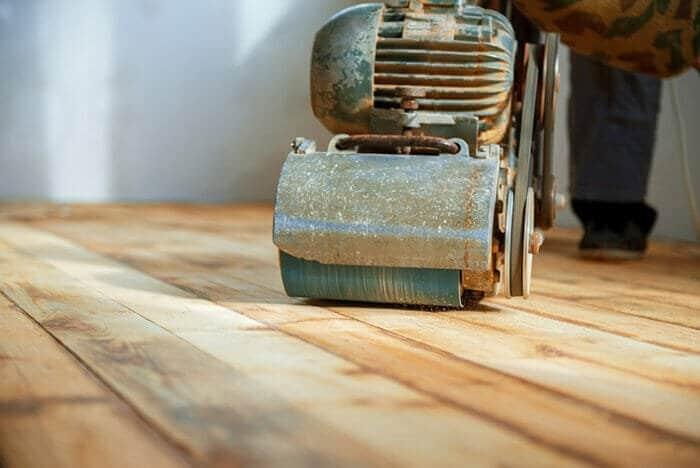 drum sander being used on a hardwood floor